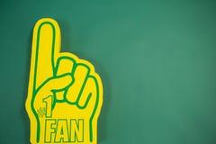 Piankowa ręka na zielonym tle Obraz Royalty Free