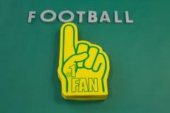 Piankowa ręka na zielonym tle Zdjęcia Stock