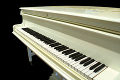 Piano. White Piano isolated on black Royalty Free Stock Photos