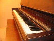 Piano. Upright piano in soft lighting Stock Photo