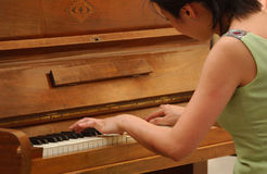 Piano. Japanese woman playing classical piano royalty free stock images