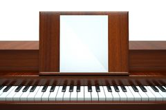 Piano. A play your own music, piano with paper on white Royalty Free Stock Photo