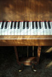 Piano. Part of the piano shined by the sun Royalty Free Stock Images