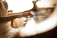 Piano. Detail of the female piano player Royalty Free Stock Image