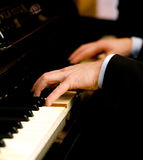 Piano. Close up of a musician playing a piano keyboard Royalty Free Stock Photos