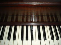 Piano. An old, mahogany spinnet piano stock image