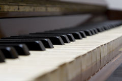 Piano. Macro of an old upright piano keyboard Royalty Free Stock Photos