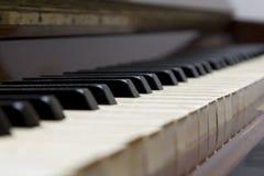 Piano. Macro of an old upright piano keyboard royalty free stock photos