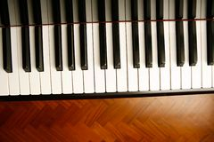 Piano. Detail of keys on a piano ready for concert Stock Photos