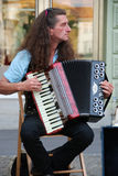 Piano accordion player Stock Images