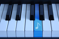 Piano with an audio key Royalty Free Stock Photos