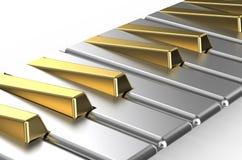 Piano avec des clés d'or et argentées Photo stock
