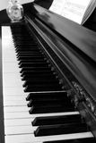The Piano Awaits. Black and white of piano with song book and tip jar Stock Photo