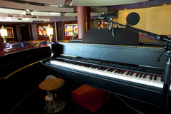 Piano Bar. Cocktail lounge and piano bar onboard a luxury cruiseliner Stock Photo