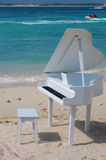 Piano on beach Royalty Free Stock Photos