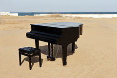 Piano on the beach. Grand piano on the beach,outdoor Stock Photos