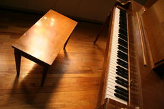 Piano Bench. In the light stock photos