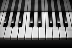 Piano / Black and White. Close up on Piano keys black and white toning Royalty Free Stock Images