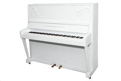 Piano blanc d'isolement sur un fond blanc Photographie stock