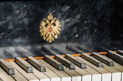 Piano with blazon Royalty Free Stock Image