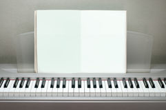 Piano books vacant post on the piano. Stock Images