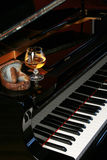 Piano with brandy and hand rolled cigar Royalty Free Stock Photo
