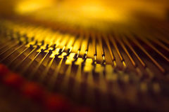 Piano bridge and strings blurred background. royalty free stock images