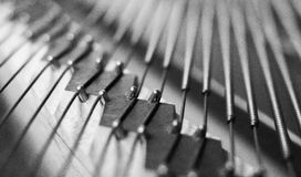 Piano bridge and strings closeup. royalty free stock photos