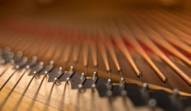 Piano bridge and strings closeup. royalty free stock photo