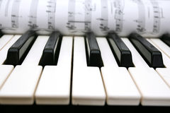 Piano buttons and notes Royalty Free Stock Photos