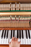 Piano. Chord playing on an old upright piano Stock Photo