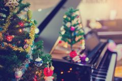 Piano and Christmas tree for christmas holiday background royalty free stock photography