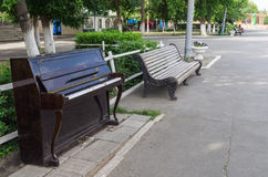 Piano in city park Royalty Free Stock Image