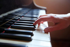 Piano. Classical music, hand touches piano keys stock photography
