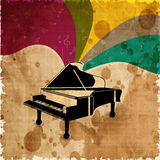 Piano on colorful grungy background. Royalty Free Stock Image