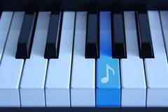 Piano com uma chave audio Fotos de Stock Royalty Free