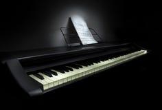 Piano con música de hoja Imágenes de archivo libres de regalías