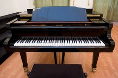 Piano on the concert room. Black piano on the concert room Stock Photography