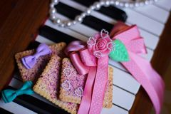 piano cookie ribbon Royalty Free Stock Image