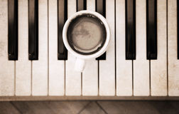 Piano and cup of coffee Royalty Free Stock Photography