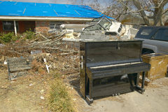 Piano and debris in front of house heavily hit by Hurricane Ivan in Pensacola Florida Royalty Free Stock Images