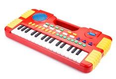 Piano del juguete de los niños en blanco Imágenes de archivo libres de regalías
