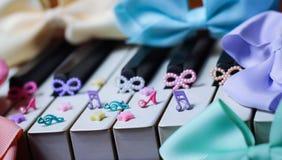 piano ebony ivory colorful music ribbon melody stars Royalty Free Stock Photography