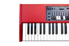 Piano eléctrico rojo Imagenes de archivo