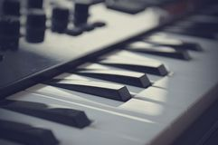 Piano or electone midi keyboard, electronic musical synthesizer white and black key. Vintage effect, instagram filter Stock Photography