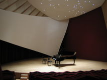 Piano on the empty stage royalty free stock photography