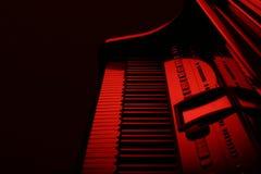 Piano en rojo foto de archivo