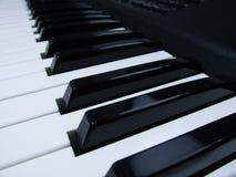 Piano en toetsenbord muzikaal instrument royalty-vrije stock afbeeldingen