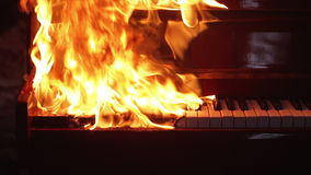 Piano on fire musical instrument stock video