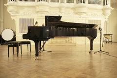 Piano-forte on organ background. Concert hall before a concert of classic music Stock Image